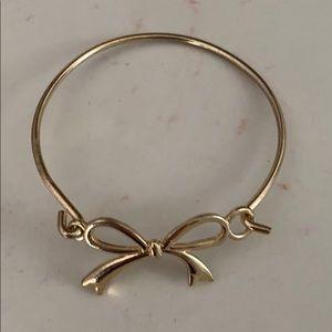 Gold bow bangle bracelet